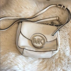 White Michael Kors crossbody with silver chain